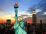 the-statue-of-liberty-and-new-york-city-skyline-at-dark.jpg